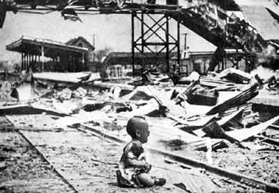 Child in ruins of bombing