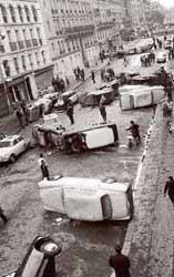 Paris with overturned cars