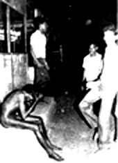 Photo of a stripped Tamil youth shortly before he is doused with gasoline and set afire